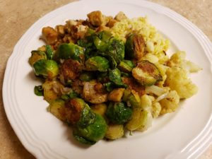 plated food with pile of roasted brussels sprouts